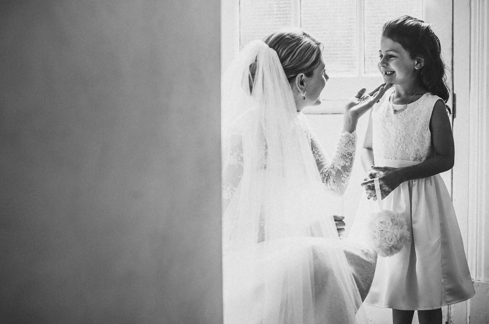 Bridebook.co.uk- bride and flower girl smiling