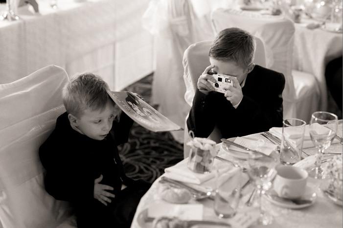 Bridebook.co.uk- children taking photos with disposable cameras at wedding