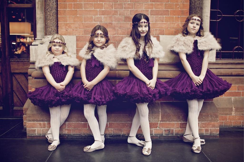 Bridebook.co.uk- four flower girls dressed as ballerinas