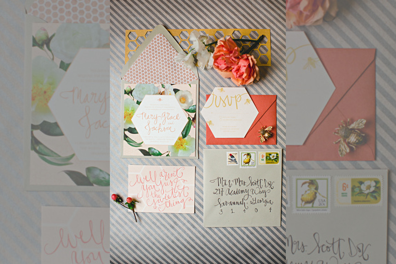 Bridebook.co.uk- bright flowers and envelopes invitation suite