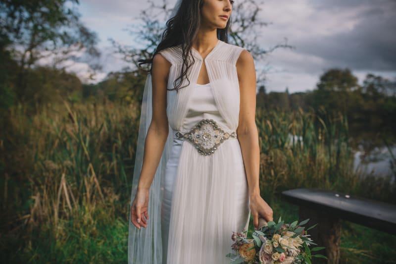 Bridebook.co.uk- bride in her wedding dress with belt embellishment