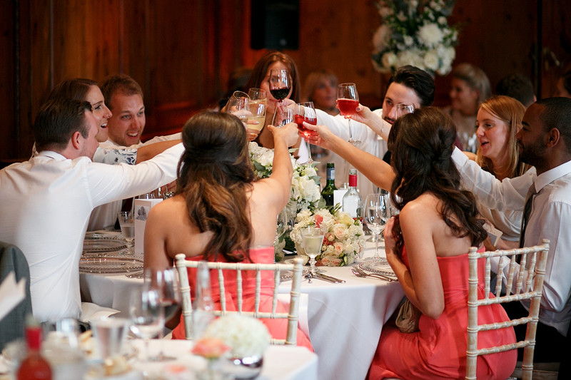 Bridebook.co.uk- guests toasting during reception