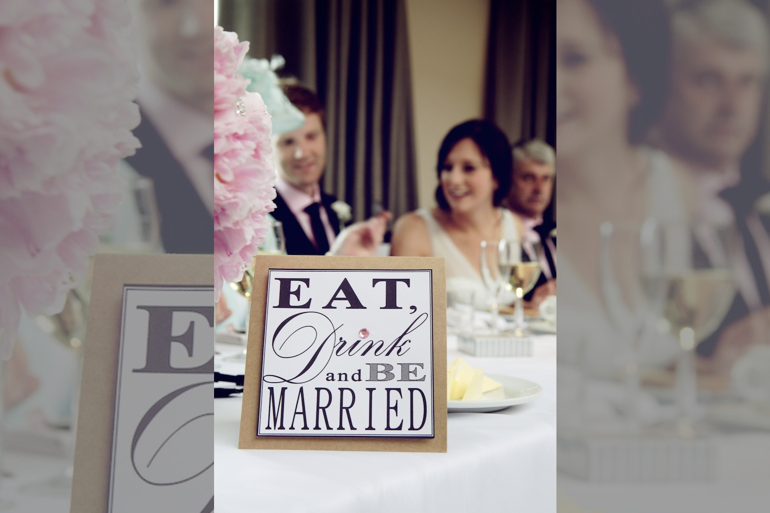 Bridebook.co.uk- eat drink and be married sign on table