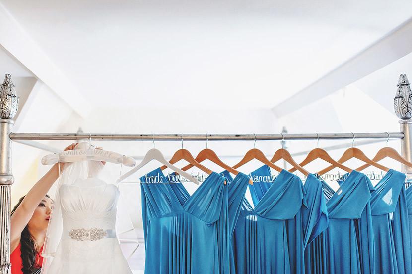 Bridebook.co.uk- wedding and bridesmaid dresses hanging on customised hangers