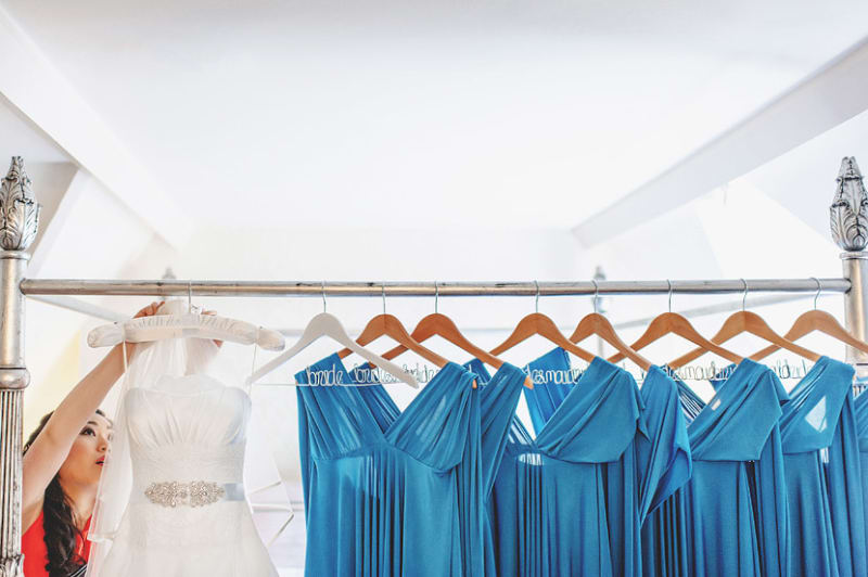 Bridebook.co.uk- wedding and bridesmaid dresses hanging on customised hangers