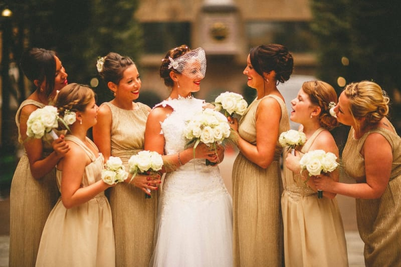 Bridebook.co.uk- bride bridesmaids and flower girl in gold dresses