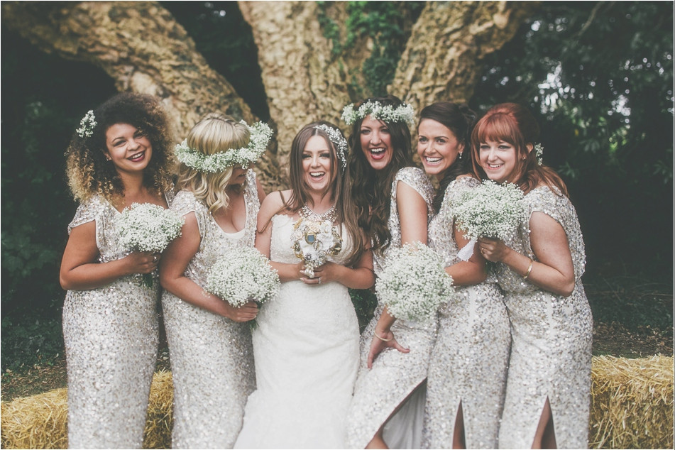 Bridebook.co.uk- bride and bridesmaids in sequenced dresses laughing