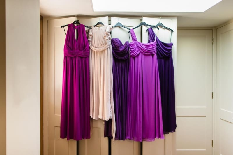 Bridebook.co.uk- mismatched bridesmaids dresses hanging up