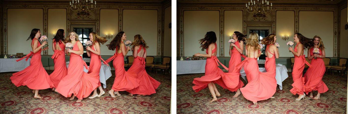 Bridebook.co.uk- bridesmaids in coral dresses twirling