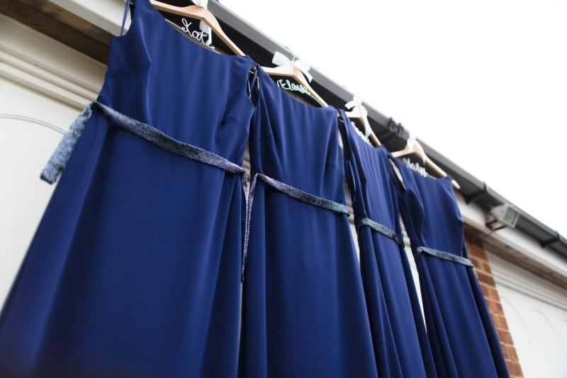 Bridebook.co.uk- navy bridesmaid dresses on customised hangers