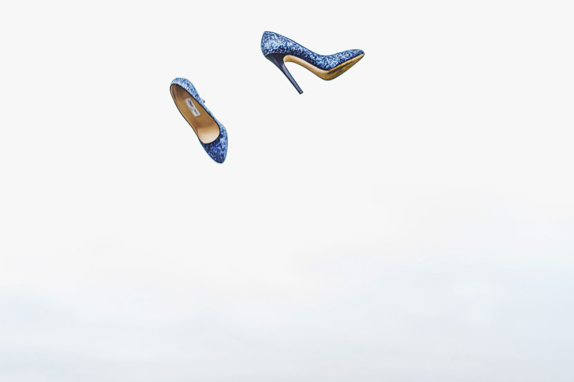 Bridebook.co.uk- blue wedding shoes thrown into the air
