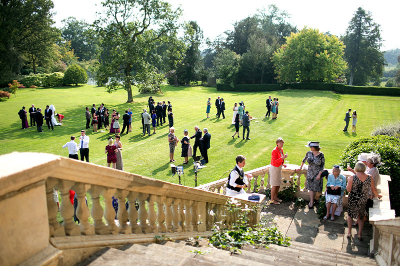 Bridebook.co.uk- wedding guests socialising on the lawn
