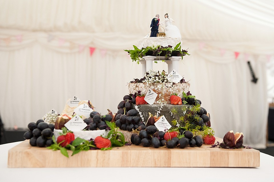 Bridebook.co.uk- cheese cake decorated with grapes and topped up with bride and groom figurines