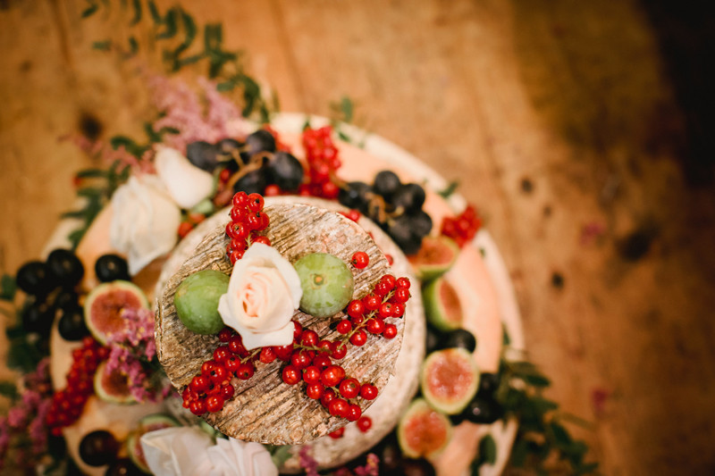 Bridebook.co.uk- cheese wedding cake decorated with berries
