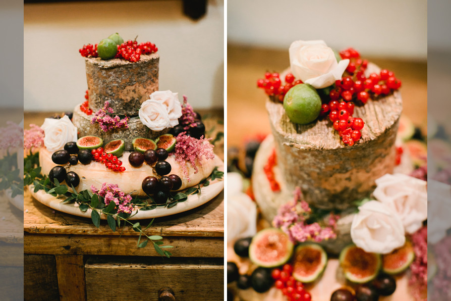Bridebook.co.uk- three layer cheese cake with berries and white roses