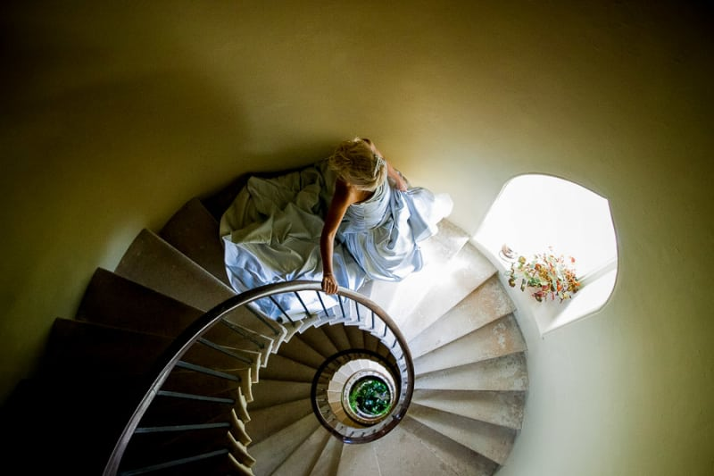 Bridebook.co.uk- bride in ice blue dress walking down the stairs