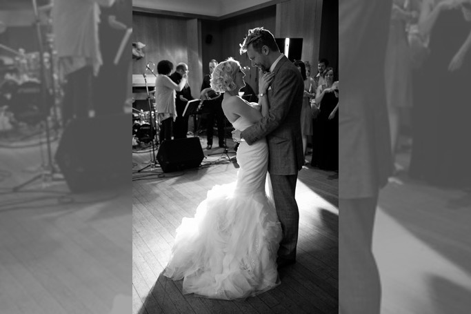 Bridebook.co.uk- bride in fishtail gown and groom dancing