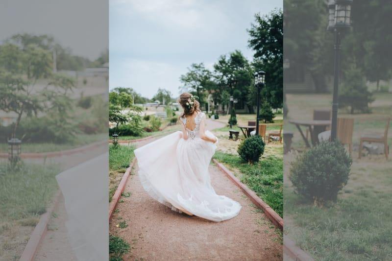 bridebook.co.uk bride running through garden in wedding dress with lace trim