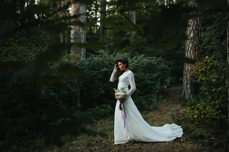 Bridebook.co.uk Boho bride at woodland wedding with long sleeved lace wedding dress