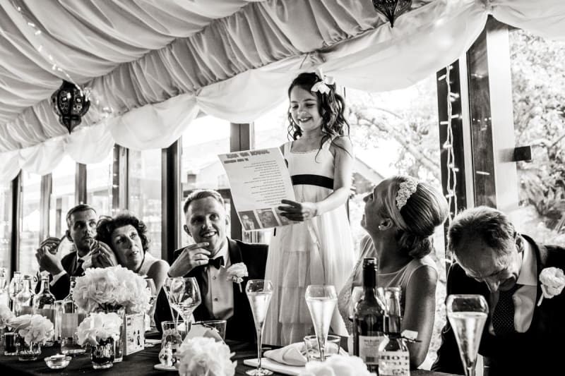 Bridebook.co.uk- flower girl reading to the guests