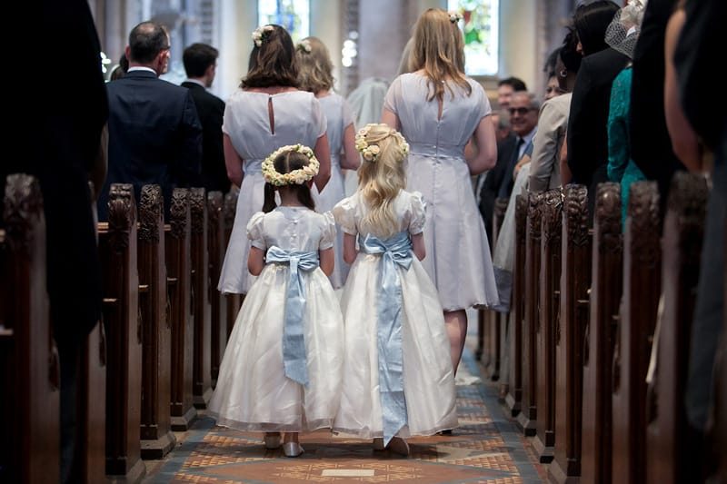 Bridebook.co.uk- flower girls walking behind bridesmaids