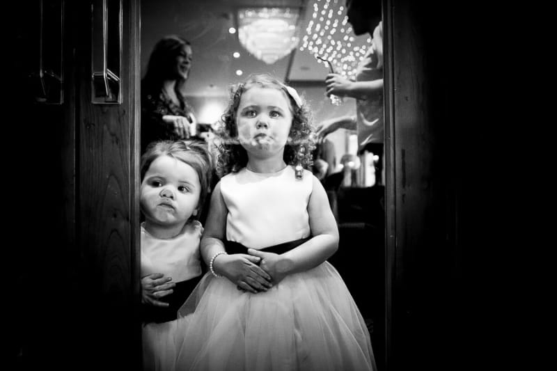 Bridebook.co.uk- flower girls pressing up faces against glass