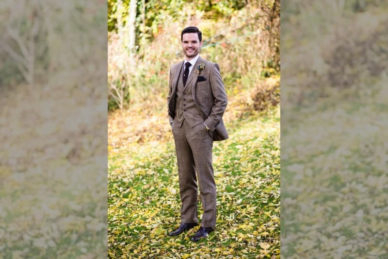 Bridebook.co.uk- groom in tweed suit