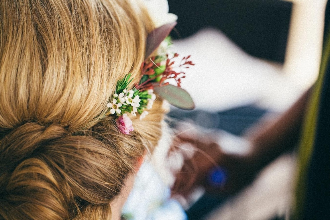 Bridebook.co.uk- close up of bridal hair with flowers decorating it