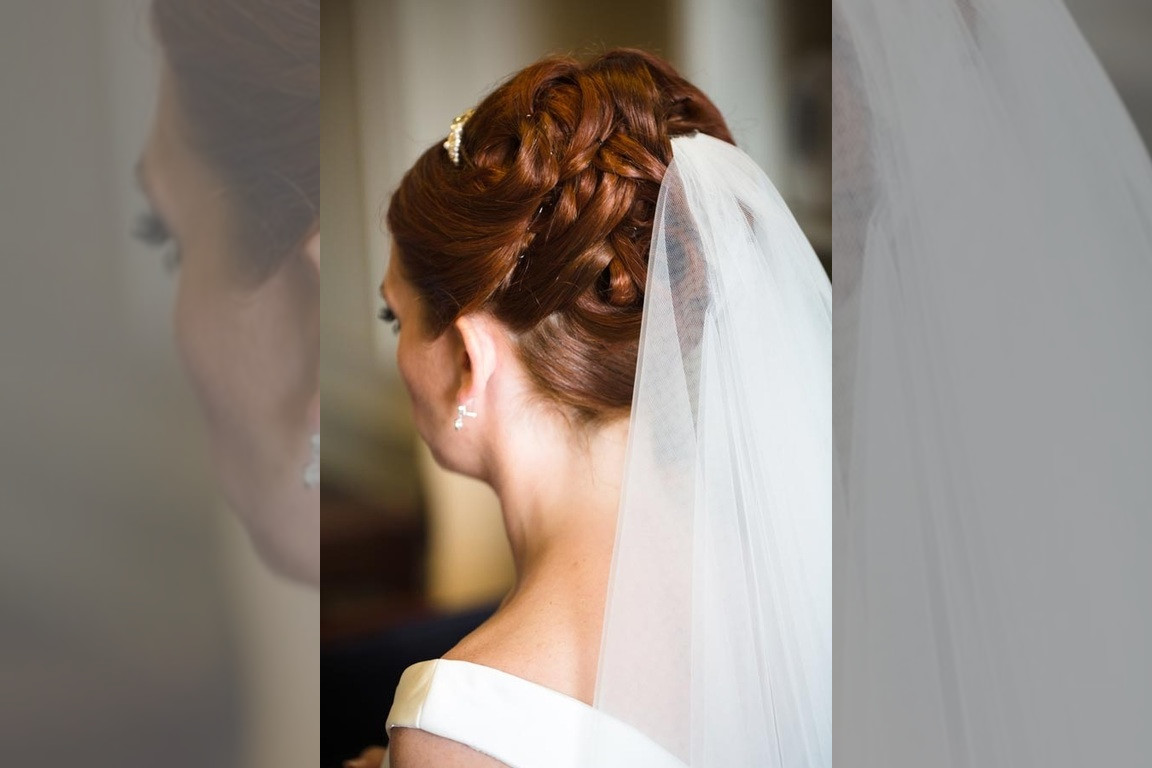 Bridebook.co.uk- bride hair in updo with veil attached