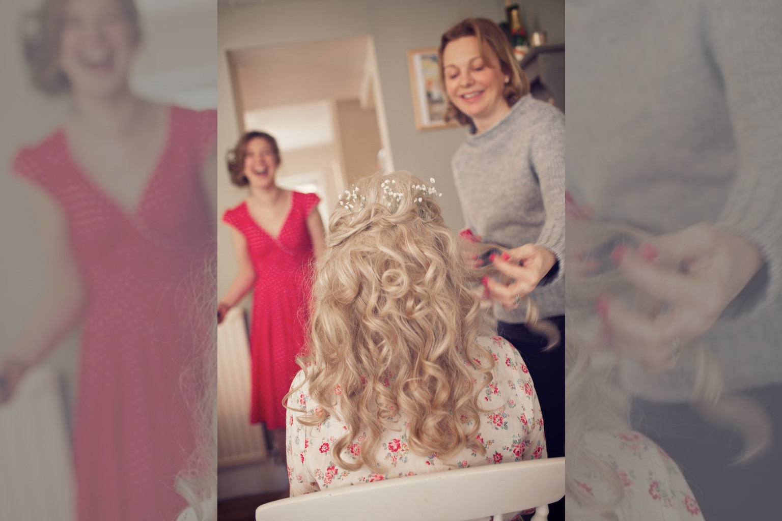 Bridebook.co.uk- bride having her hair curled and decorated with flowers