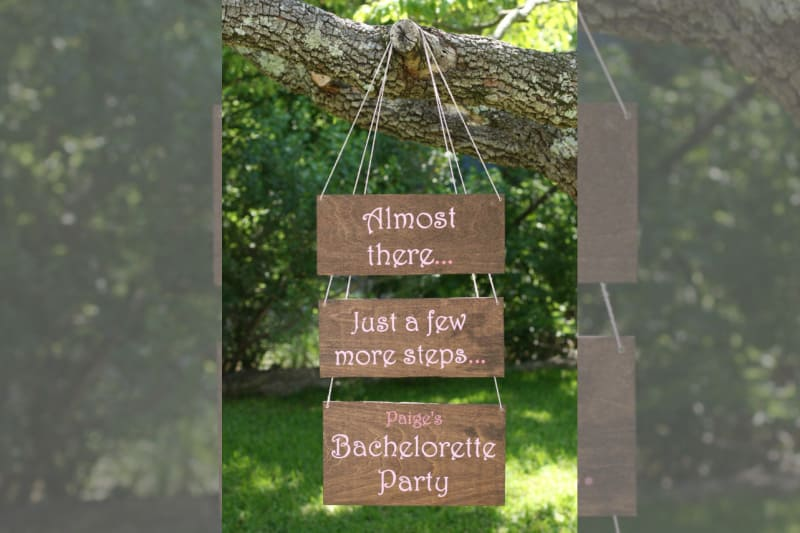 Bridebook.co.uk- wooden sign pointing to the bachelorette party