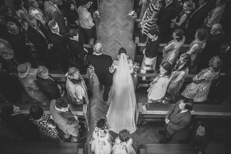 Bridebook.co.uk- father and bride walking down the aisle view from above