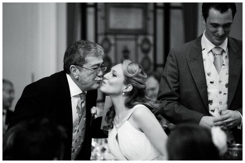 www.bridebook.co.uk bride and father sharing a kiss on the cheek