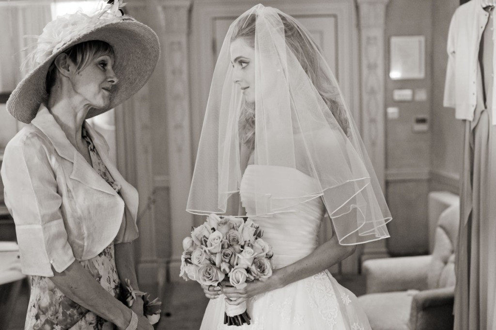 Bridebook.co.uk- mother and bride looking at each other before the ceremony