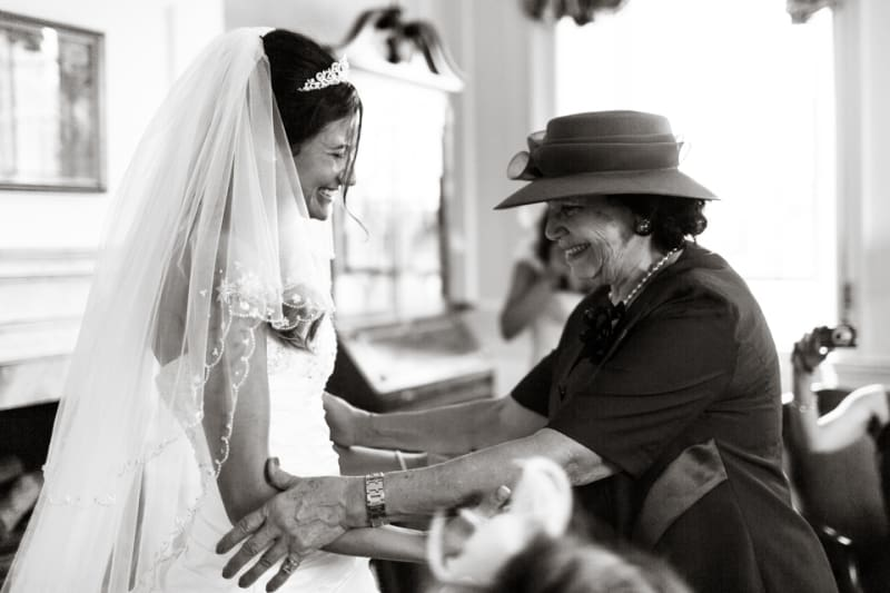 Bridebook.co.uk- mother and bride hugging and smiling
