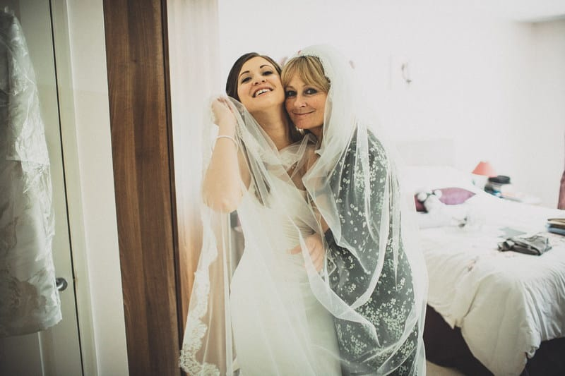 Bridebook.co.uk- mother and bride hugging under the veil