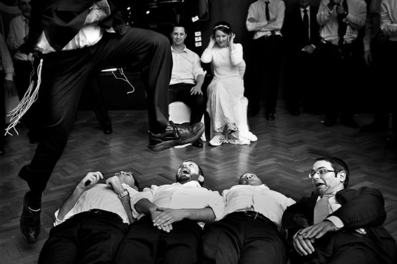 Bridebook.co.uk- bride and groom watching ushers