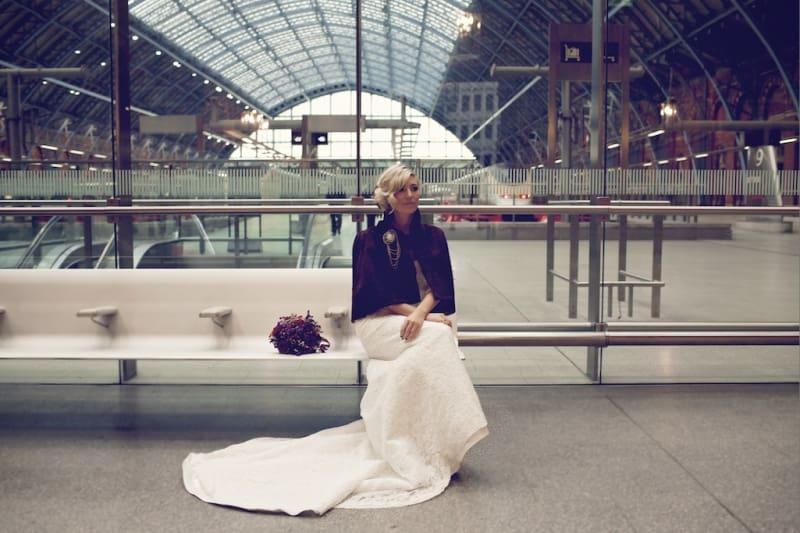 Bridebook.co.uk- bride sitting at st pancras