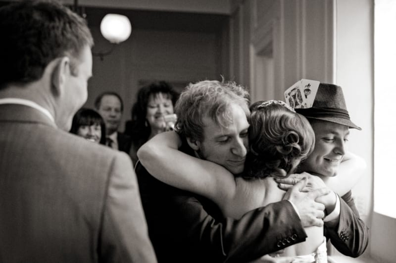 Bridebook.co.uk- bride hugging guests