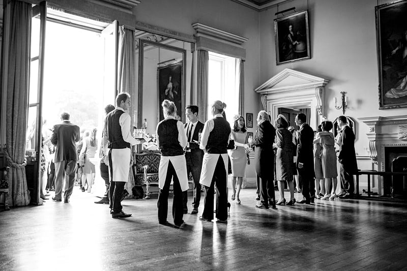 Bridebook.co.uk- guests being greeted by wedding party and champagne