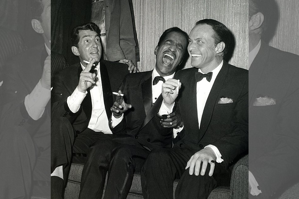 Bridebook.co.uk- rat pack  in tuxes laughing