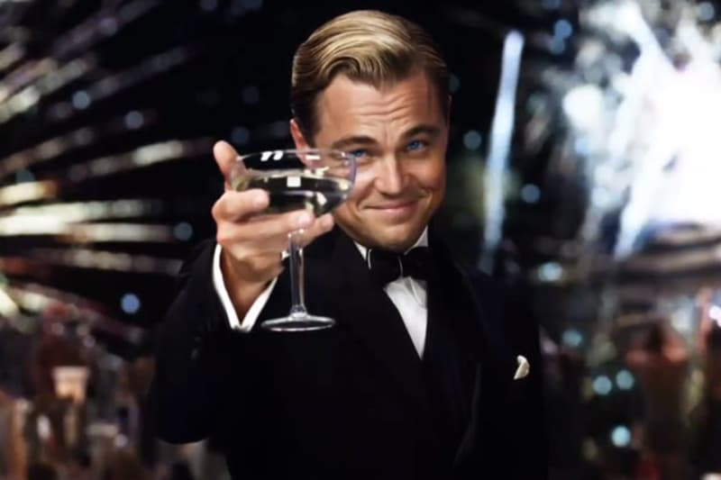 Bridebook.co.uk-  leonardo di caprio toasting with champagne glass