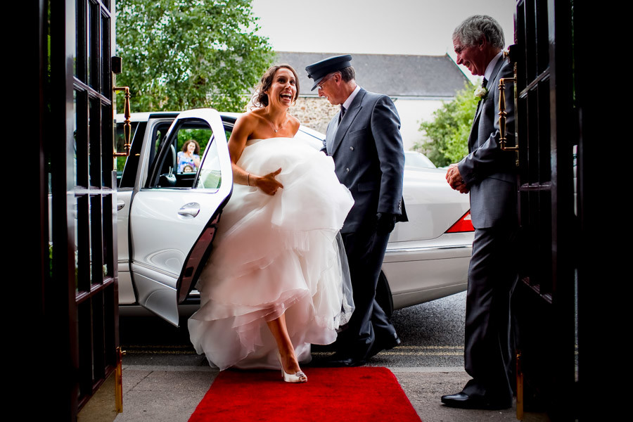 Bridebook.co.uk- bride stepping out of wedding car