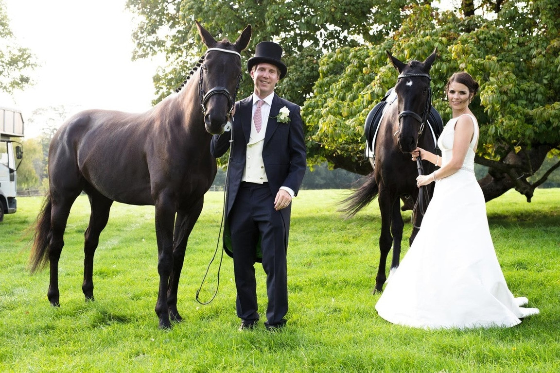 Bridebook.co.uk- bride and groom with two horses
