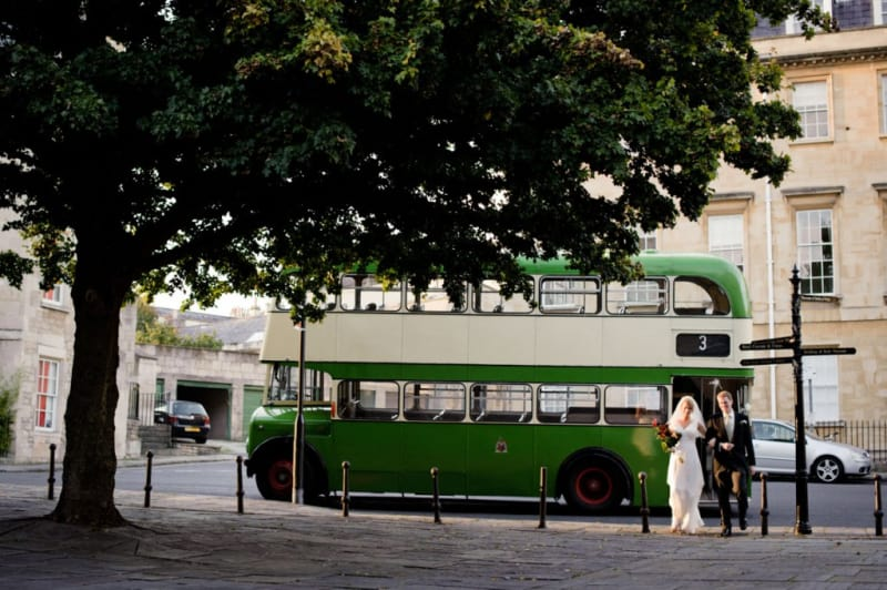 Bridebook.co.uk- bride and groom with green london bus