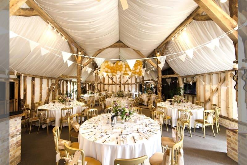 Bridebook.co.uk- wedding venue barn decorated with bunting