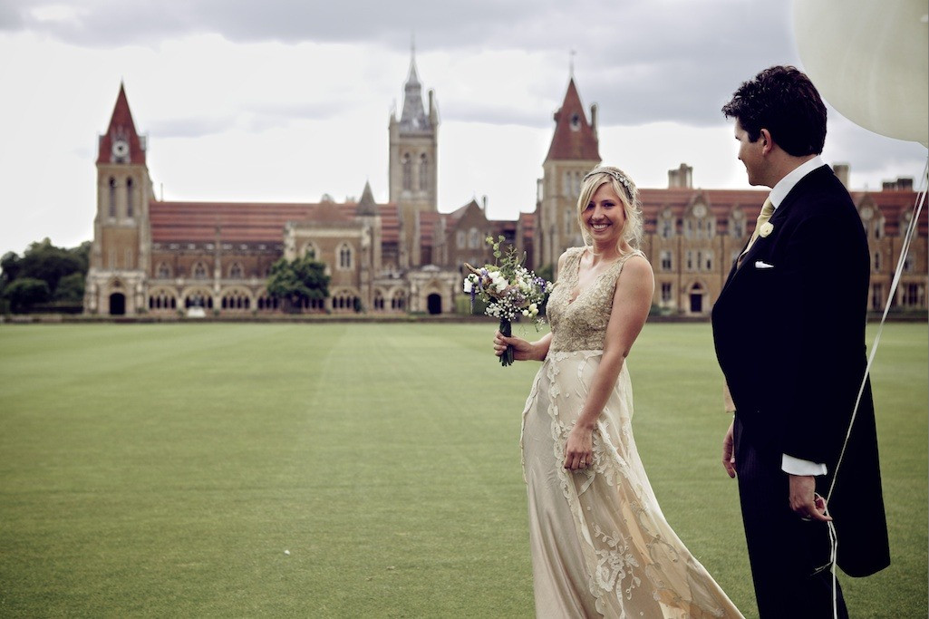 Bridebook.co.uk- bride and groom walking outside wedding venue