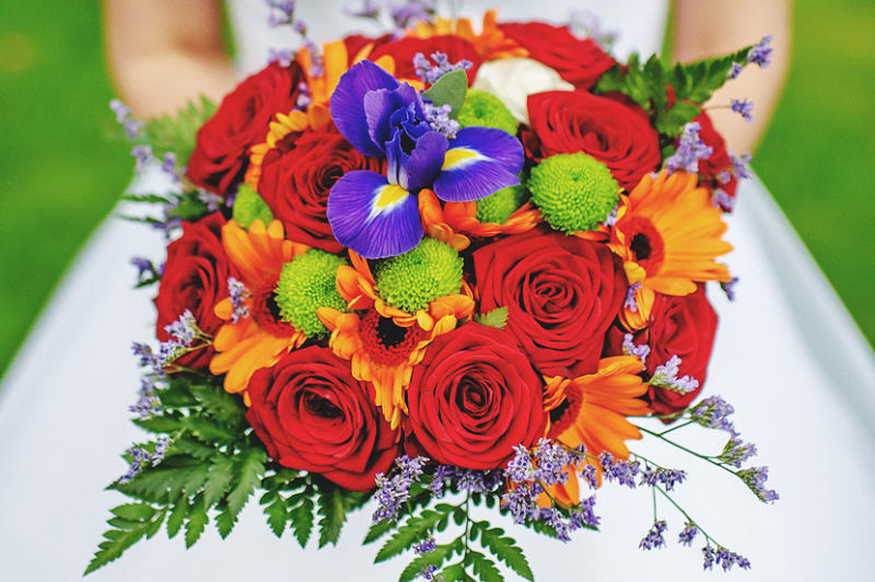 Bridebook.co.uk- red roses and bright flowers bridal bouquet