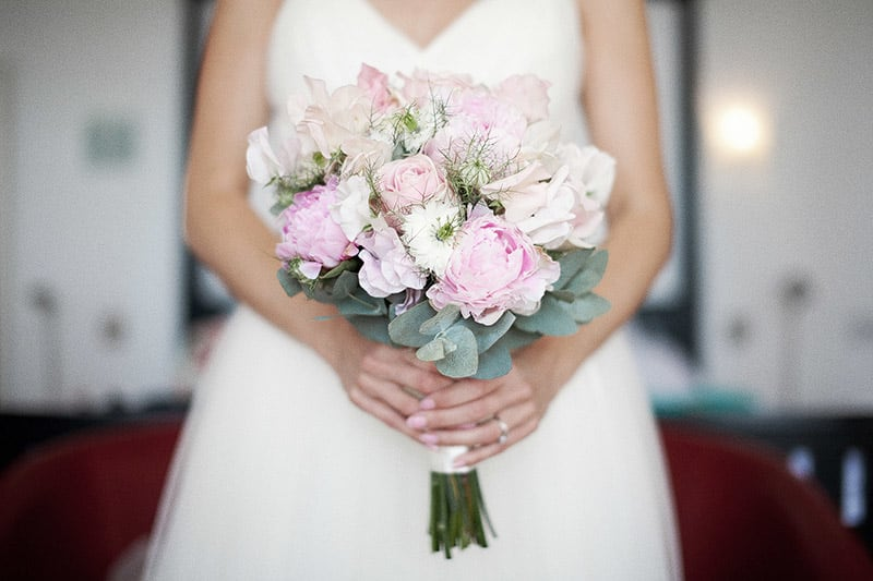 Bridebook.co.uk- Bride holding up pink and white bouquet