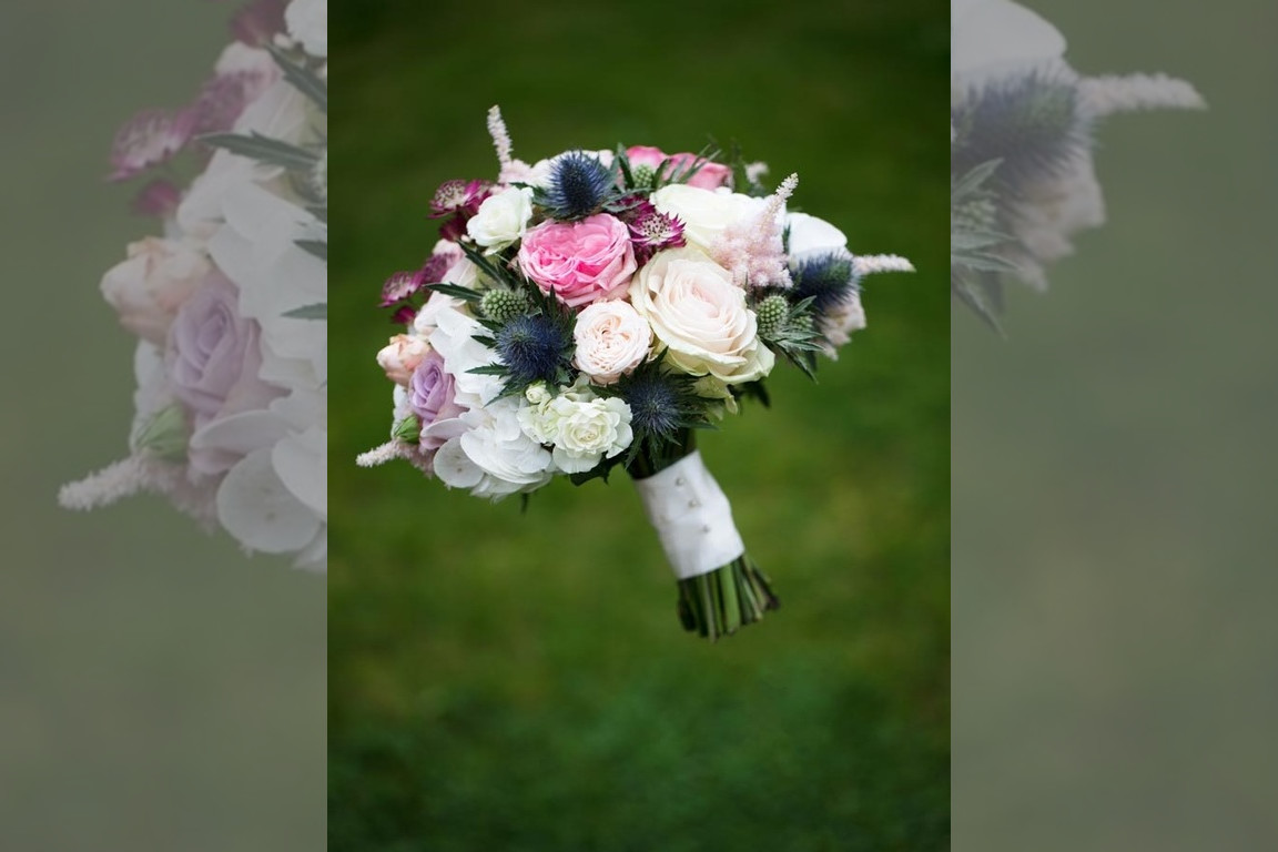 Bridebook.co.uk- hand tied bouquet with roses